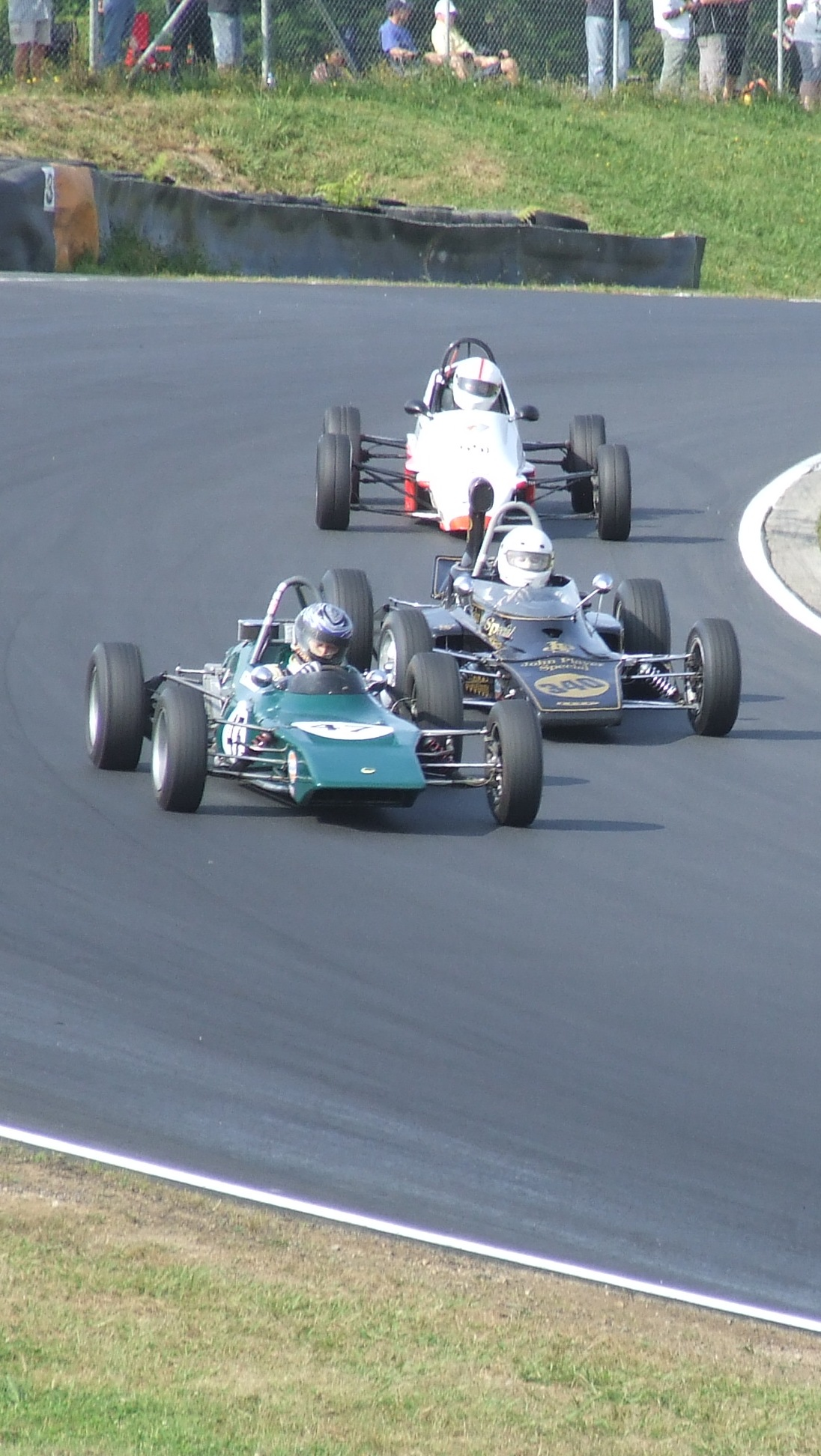 Martin Lucas holds off Tony Cross, as Mike Lee holds onto their tails