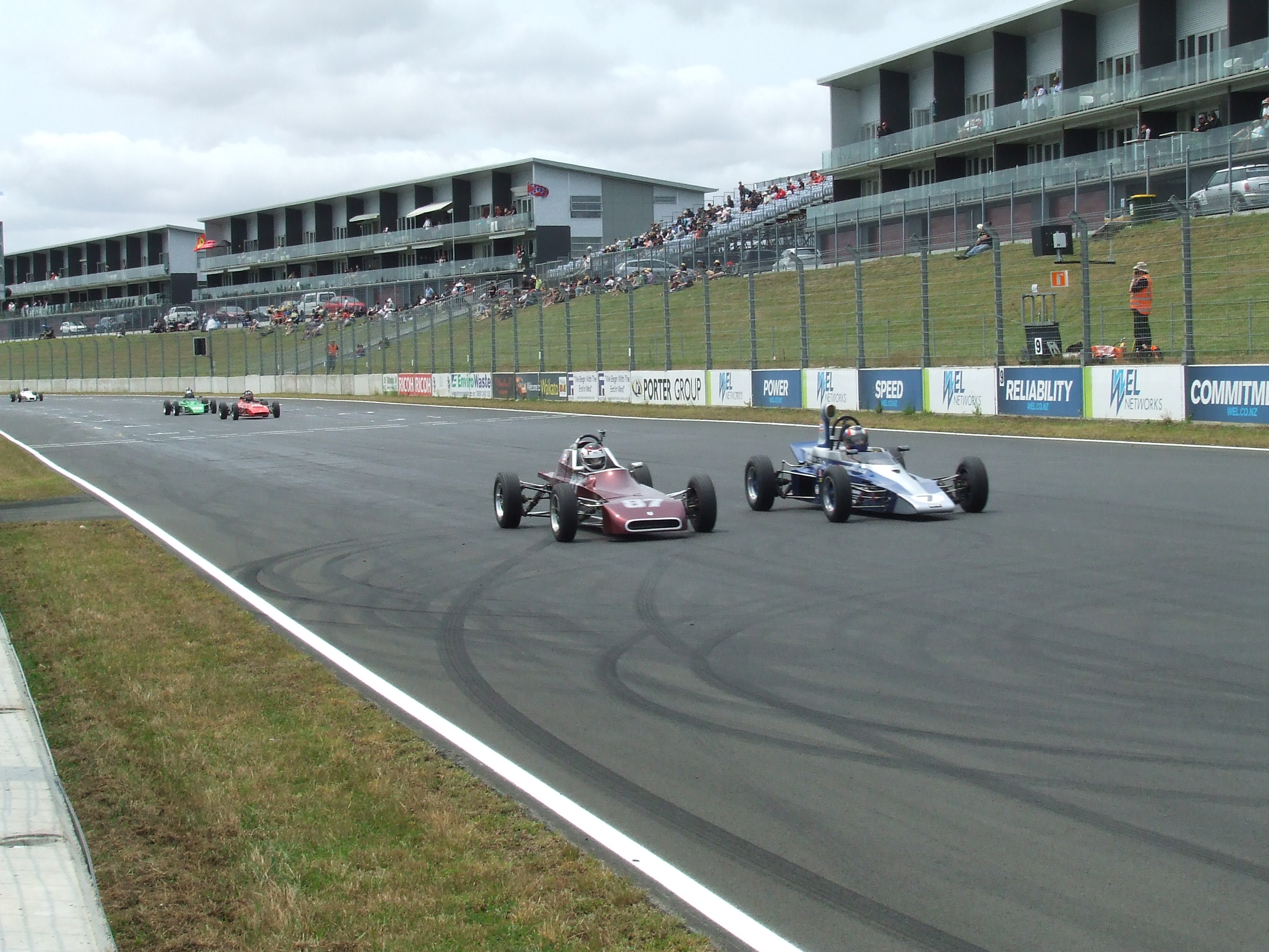 Jacob Bonish (87) and Mike Creswell (7) head to the first corner, neck and neck